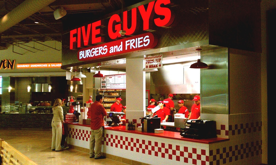 five guys burgers A basic five guys burger consists of two hamburger patties and can be augmented with as many toppings as you'd like at no additional cost, with the sole exception of bacon according to the five guys website, a plain hamburger contains 700 calories, 43 grams of fat and 195 grams of saturated fat.